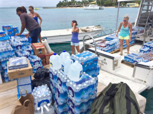 Volunteers load supplies aboard Caribbean Sea Adventures vessel on Sept. 10, between hurricanes. FEMA reported it has 14 million liters of water position in case a storm strikes the territory this season. (Photo by Sarah Ridgway)
