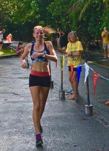Katrina Lindsay passes the finish line as Lani Clark checks her time.