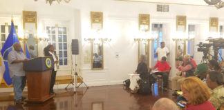 Gov. Kenneth Mapp, at the far left, gives his daily update on hurricane recovery efforts to the gathered news media. The update took place at Government House on St. Croix.