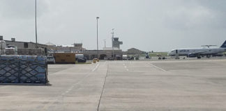 On the tarmac at Henry Rohlsen Airport, a Jet Blue mercy flight prepares to leave, while hurricane relief supplies are stacked in the foreground. (Jamie Leonard photo)