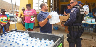 Crew from Coast Guard Cutter Joseph Napier offload 450 liters of water to Coral Bay, St. John. Napier's crew also provided diesel fuel to the local fire department. (U.S. Coast Guard photo)