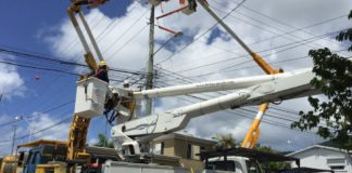 A WAPA crew works on a power line. (Photo provided by WAPA)
