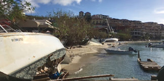 Beached and wrecked boats line Cruz Bay's waterfront.