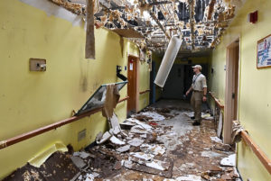 A DEMA team member assesses the damage at the Sea View Nursing Home in St. Thomas. (FEMA Photos by Jocelyn Augustino)