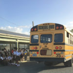 Students unload from a school bus at St. Croix Central High School in a 2017 file photo. (Source file photo)
