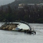 A sunken boat lies in the water off St. Thomas.