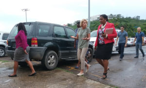 U.S. Secretary of Education Betsy deVos, center, visits Charlotte Amalie High School as part of her visit to observe hurricane damage to the territory's schools.