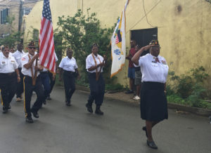 Crucian veterans march through Frederiksted Saturday in honor of Veterabs Day.