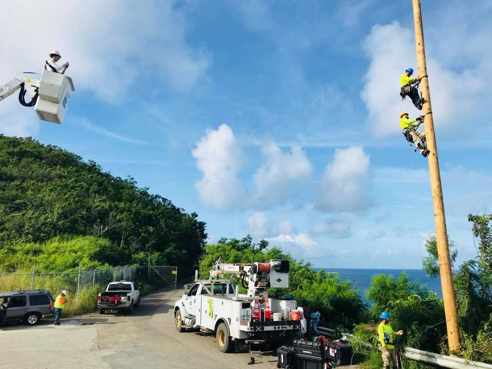 The USVI Hurricane Heroes calendar features first responders and lineman who came to the territory's aid. (Photo by Rebecca Howe)