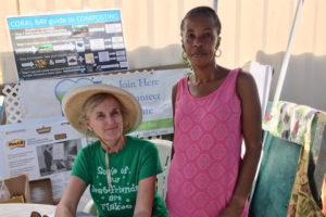 Sharon Coldren of Coral Bay Community Council and Linda Titre, a Hard Labor resident, enjoy the Bizarre Bazaar.