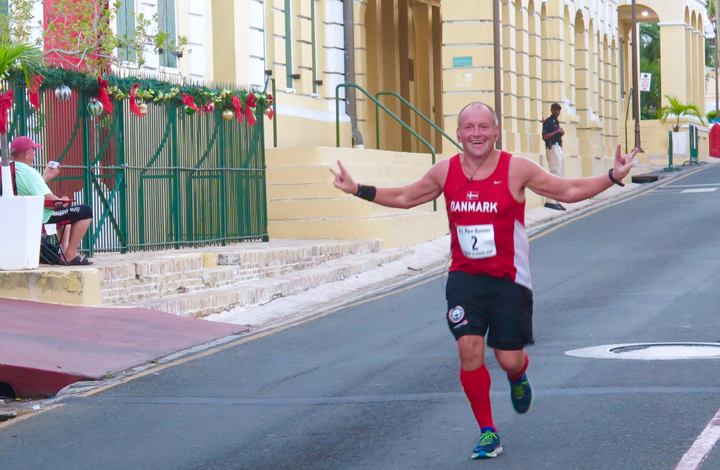 Peter Olsen of Denmark passes Government House Sunday in the 16th annual St. Croix Marathon. (Submitted photo)
