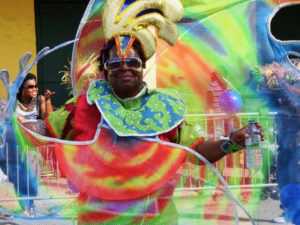 A parade participant is resplendent in tie dye as she cruises down the parade route Sturday. (Anne Salafia photo)