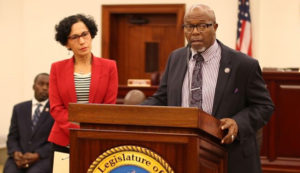 Senate President Myron Jackson, flanked by members of the Majority Caucus, speaks about the Senate's contributions to hurricane relief efforts.