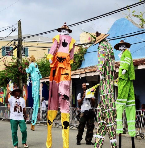 Moko Jumbies dance through Frederiksted with their heads among the power lines. (Anne Salafia photo)