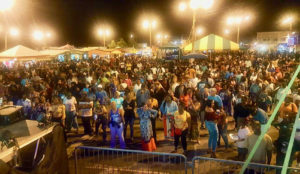 A big crowd enjoys the show at the Festival Village stage. (From Crucian Christmas Festival's Facebook page)