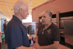 Former President Bill Clinton meets with community members, including India Association president Pash Daswani, to talk about hurricane recovery issues.
