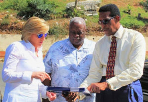 From left: HUD Deputy Secretary Pamela Hughes Patenaude, Gov. Kenneth E. Mapp and V.I. Housing Authority Executive Director Robert Graham, review plans for the demolition of Tutu High Rise.