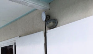 The NanoBeam, the white bulb-like object above the gray porch light, points at an LCCN distribution point.