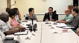 Vivek Daswani, center right, talks about issues facing the community during Tuesday's meeting of the Ports Of Charlotte Amalie Task Force. (Government House image)