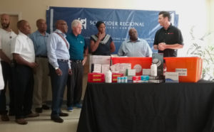 Bill Clinton joins officials from the V.I. Government and Schenider Regional Medical Center as representatives of Direct Relief International, bring four cases of hospital supplies to the hospital.