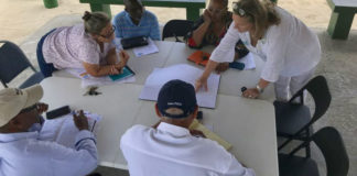 Magens Bay Authority board members review a concept for a new equipment rental shed at the beach.