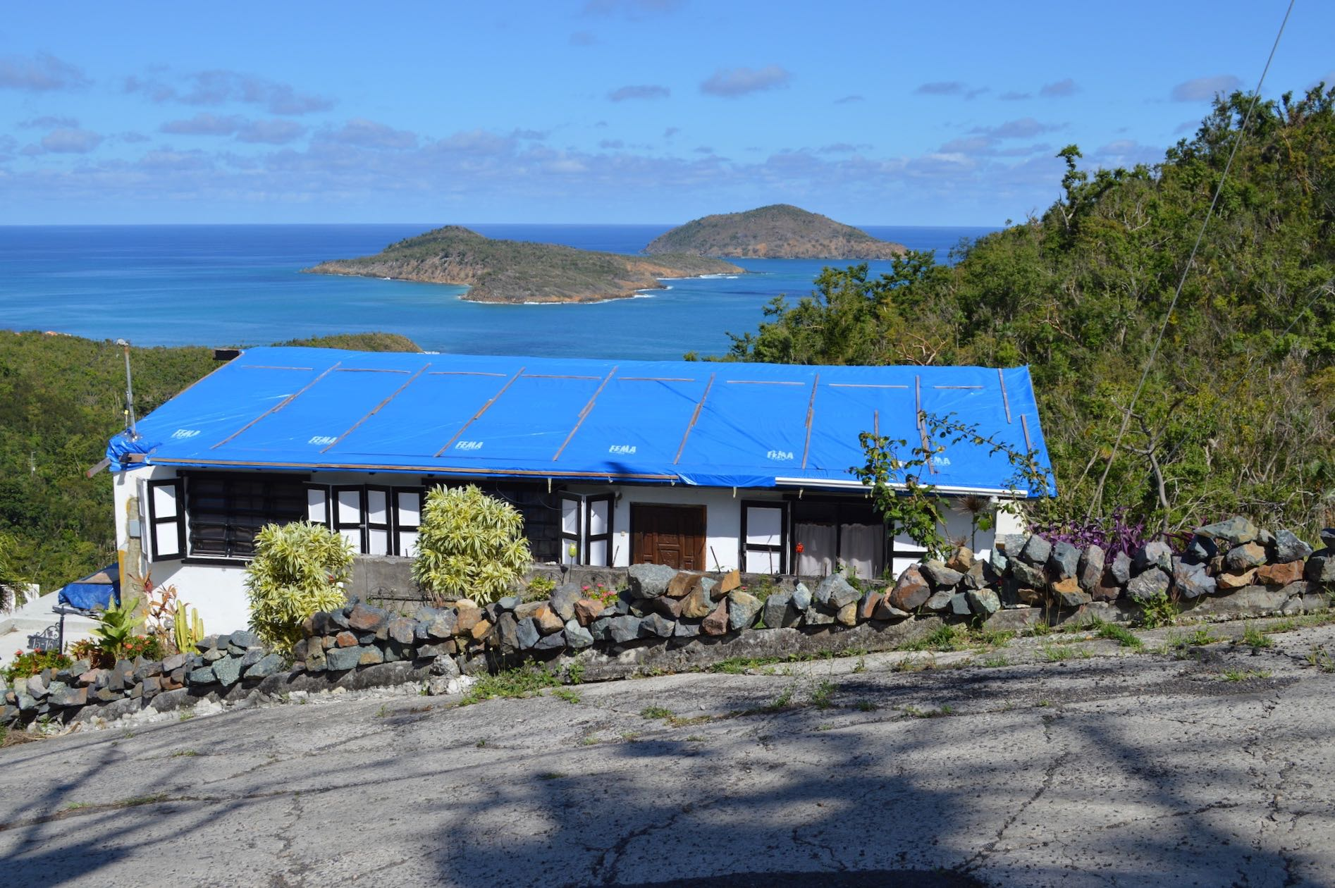 Blue tarps covering damaged roofs dot the landscape of Estate Tutu on St. Thomas in March 2018 after 2017's pair of hurricanes battered the territory. (Bill Kossler photo)