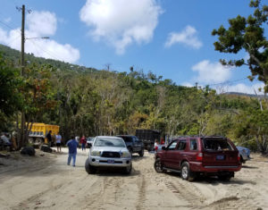 Residents block the road to assure that DPNR instructions to stand down are followed.