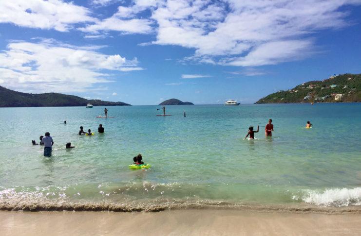 Families enjoy a sunny Sunday at Magens Bay Beach on St. Thomas