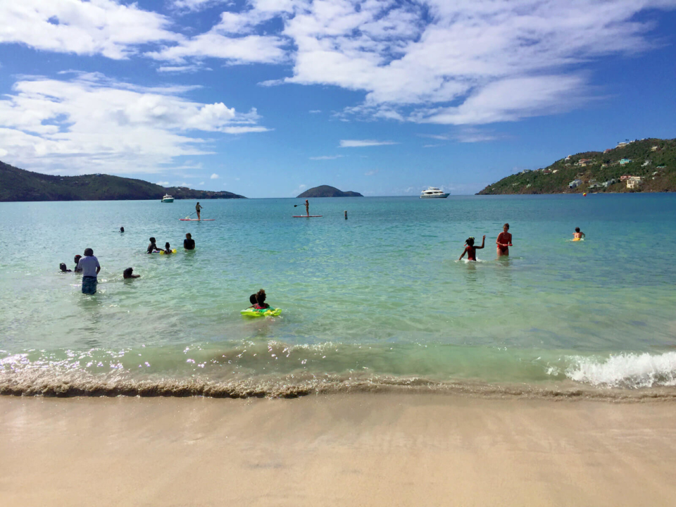 Families enjoy a sunny Sunday at Magens Bay Beach on St. Thomas