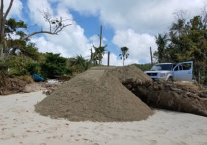 A small pile of sand was returned to the beach after DPNR ordered the DPW to 'stand down.'