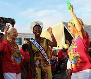 From left, 1952 Carnival Queen Carmen Sibilly joins 2018 Carnival Queen Jikelle Michael and Judy Watson for Friday's opening of the Carnival village, named in Watson's honor.