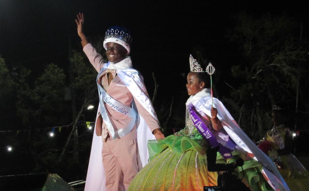 Prince Maike Caracciolo and Princess Ta'Mya Davis wave at the crowd Sunday at the Vita Malt V.I. Carnival Prince and Princess Selection Pageant.