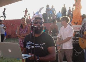 Fish fry organizer Kemit-Amon Lewis talks to the crowd.