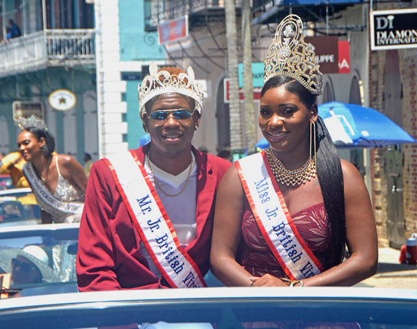 The Junior BVI royalty, Yohance Smith and Miss Anondha, enjoy the ride down Main Street. (Gerard Sperry photo)