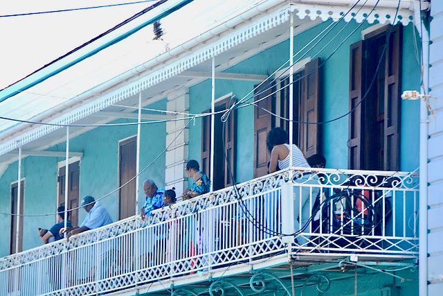 A shaded balcony offers a fine perch for watching the parade roll down Main Street. (Gerard Sperry photo)
