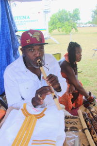 "Sneferu Hotep plays a handmade flute he crafted for his ""We Shoot Flutes"" peace initiative."