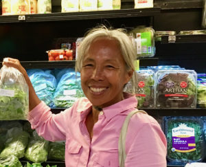 Josephine Roller holds a bag of her organic greens.