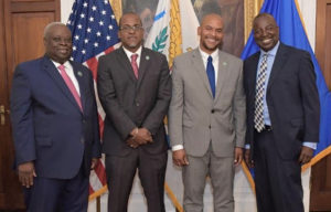 From left, Gov. Kenneth Mapp, Budget Director Julio Rhymer, Public Works Commissioner Nelson Petty Jr. and Lt. Gov. Osbert Potter pose after Tuesday's swearing-in ceremony. (Government House photo)