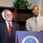 BMV Director Lawrence Olive and Attorney General Claude Walker.