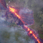 A fiery fissure from Kilauea oozes a thick paste of lava across the Hawaiian countryside.