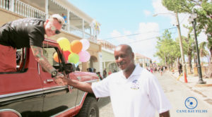 St. Croix Police Chief Winsbut McFarlane, who oversaw the police presence at Saturday's parade, greets a participant. (Photo provided by Johanna Bermùdez-Ruiz and Cane Bay Films)