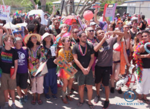 Enthusiastic opponents of discrimination and supporters of equality and dignity for everyone lined the Pride Parade route in Frederiksted Saturday. (Photo provided by Johanna Bermùdez-Ruiz and Cane Bay Films)