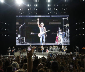 Kenny Chesney takes the stage at Philadelphia's Lincoln Financial Field, backed by a giant television screen. The audience of more than 60,000 included an enthusiastic party from St. John. (Photo by William Stelzer)