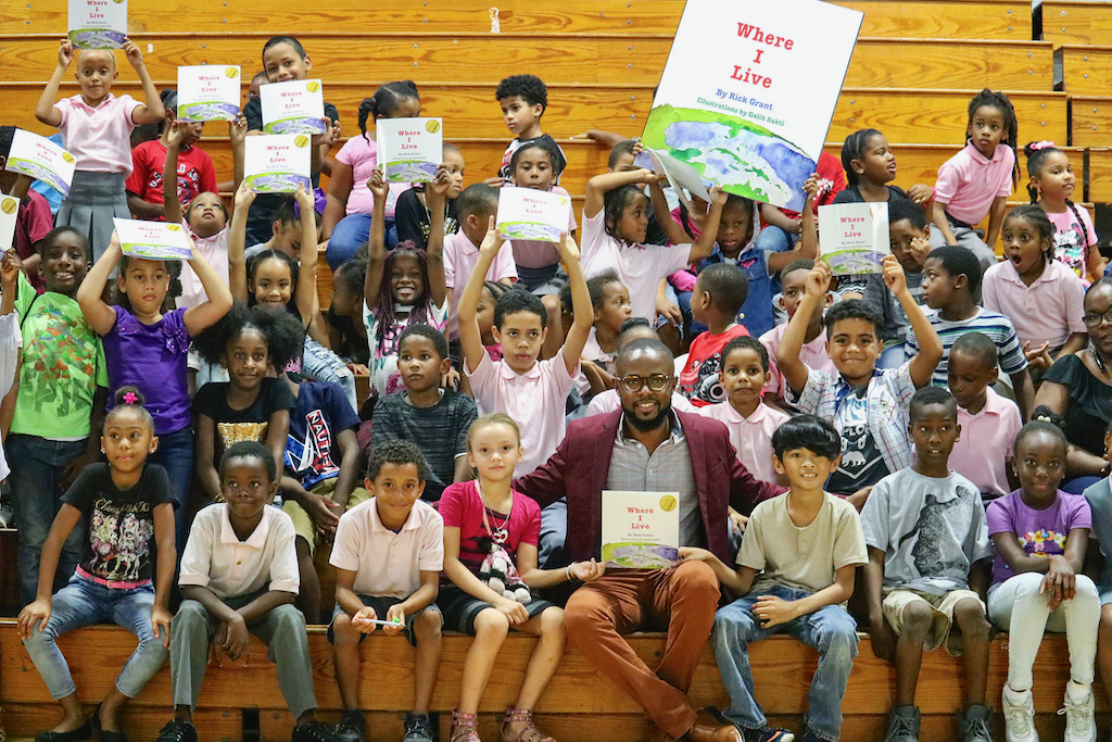 Students join author Rick Grant at Saturday's rally kicking off the 10th Governor's Summer Reading Challenge.