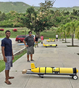 Four Ocean Gliders sit with a clear look into the sky to find and be recognized by the satellite GPS system that will guide and track them. (Gerard Sperry photo)Four Ocean Gliders sit with a clear look into the sky to find and be recognized by the satellite GPS system that will guide and track them. (Gerard Sperry photo)