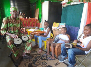 Junie Bomba teaches percussion to children in Frederiksted.