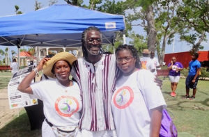 From left, Vivian St. Juste, Positive Nelson and Doris St. Juste relax in Frederiksted after the 2018 Freedom Walk. Nelson has organized the walk for years. (File photo)