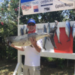David Stuedell holds up his 45.55-pound kingfish, the winning catch in Sunday's tournament.