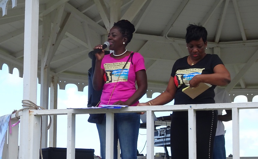 Ophelia 'Nemmy' Jackson addresses the St. Croix Women's March in January. Beside her is Carol Burke. (Anne Salafia photo)