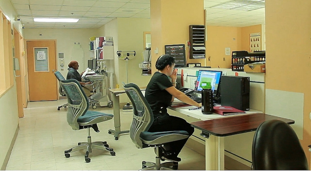 Staff nurses monitor the intensive care unit.